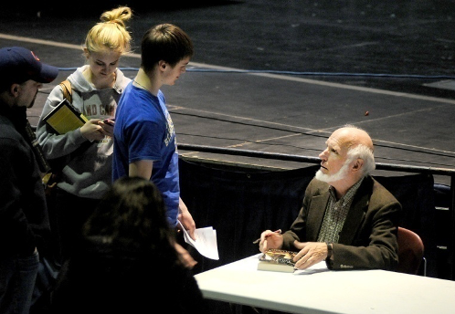 Dr. Jim Loewen speaking with students after an event